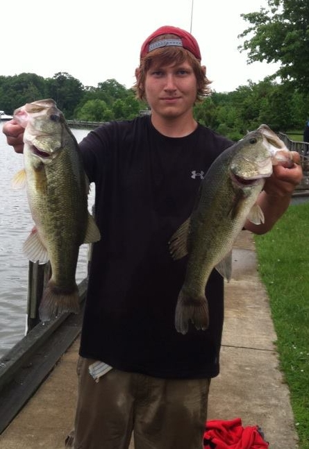 Justin with 2 of 5 bass he weighed in
